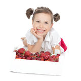 Little girl eating red fruit on white Stock Image