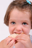 Little girl eating sandwich. Little girl eating a sandwich, isolated over white royalty free stock images