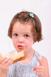 Little girl eating sandwich. Little girl eating a sandwich, isolated over white stock photos