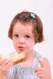 Little girl eating sandwich. Little girl eating a sandwich, isolated over white Stock Photos