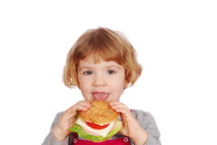 Little girl eating sandwich Royalty Free Stock Photo