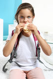 Little girl is eating a sandwich with bread Stock Photo