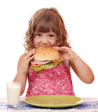 Little girl eating sandwich Stock Photos