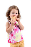 Little girl eating sandwich ice cream Royalty Free Stock Images