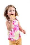 Little girl eating sandwich ice cream Stock Photos