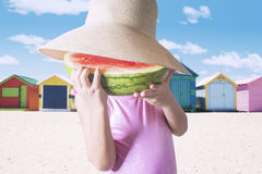 Little Girl Eating A Slice of Watermelon Stock Photos