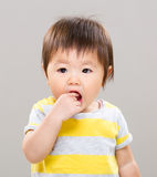 Little girl eating snack Royalty Free Stock Photos