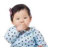Little girl eating snack Stock Photos