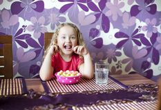 Little girl is eating Royalty Free Stock Photos