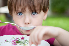 Little Girl Eating Soup. Close up of a little girl eating a bowl of soup Royalty Free Stock Images