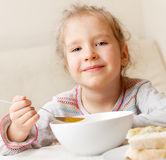 Little girl eating soup Royalty Free Stock Images