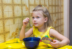 Little girl eating soup Royalty Free Stock Image
