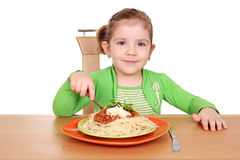 Little girl eating spaghetti Stock Photo