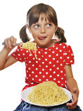 Little girl eating spaghetti with cheese Stock Photography
