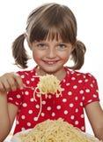 Little girl eating spaghetti close up Stock Image