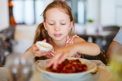 Little girl eating spaghetti Royalty Free Stock Photo