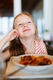 Little girl eating spaghetti Royalty Free Stock Image