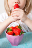 LIttle girl eating strawberries Royalty Free Stock Photo