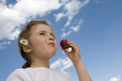Little girl eating strawberry Royalty Free Stock Image