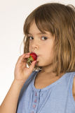 Little Girl Eating Strawberry Stock Photography