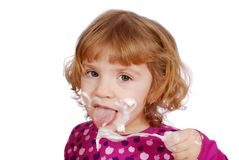 Little girl eating sweet cream Royalty Free Stock Photo