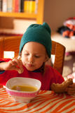 The little girl eating Stock Photos