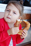 Little girl eating turkish bagel. royalty free stock photography