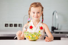 Little girl eating vegetable salad Royalty Free Stock Images