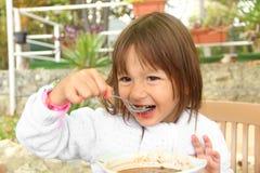 Little girl eating vegetarian soup Royalty Free Stock Photos