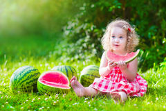 Free Little Girl Eating Watermelon Royalty Free Stock Photos - 66531358