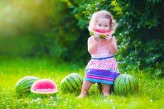 Little girl eating watermelon Stock Image