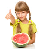 Little girl is eating watermelon Stock Image