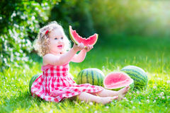Little girl eating watermelon Royalty Free Stock Photography