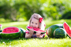 Little girl eating watermelon in the garden Royalty Free Stock Image