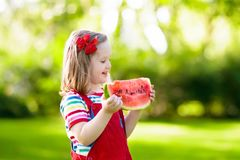 Little girl eating watermelon in the garden Stock Photography