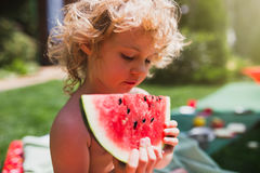 Little girl eating watermelon Royalty Free Stock Images