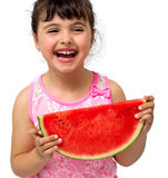 Little girl eating watermelon Stock Images