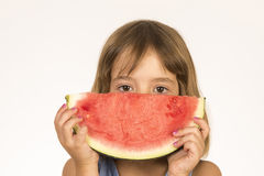 Little girl eating watermelon Stock Image