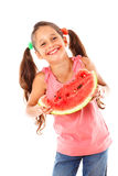 Little girl eating a watermelon Stock Photos