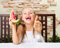 Little girl eating an watermelon Stock Photo