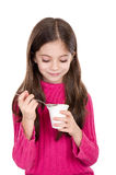Little girl eating yoghurt Stock Photos