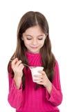 Little girl eating yoghurt Stock Photos