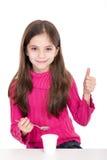 Little girl eating yoghurt Royalty Free Stock Photo