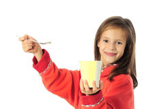 Little girl eating yoghurt Royalty Free Stock Images