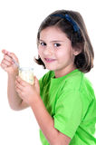 Little girl eating yogurt Royalty Free Stock Photography
