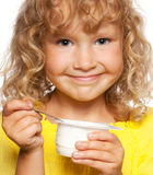 Little girl eating yogurt Royalty Free Stock Image