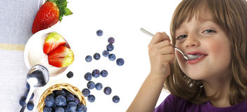 Little girl eating a yogurt Royalty Free Stock Photography