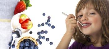 Little girl eating a yogurt Royalty Free Stock Photography