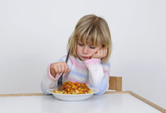 Little girl eats Royalty Free Stock Image