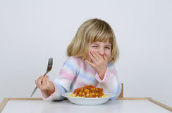 Little girl eats Stock Photography